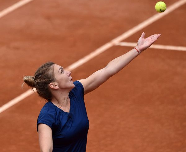 Simona Halep Photos Photos - Simona Halep of Romania in action during the women's semi-final match between Simona Halep of Romania and Kiki Bertens of the Netherlands during The Internazionali BNL d'Italia 2017 - Day Seven at Foro Italico on May 20, 2017 in Rome, Italy. - The Internazionali BNL d'Italia 2017 - Day Seven