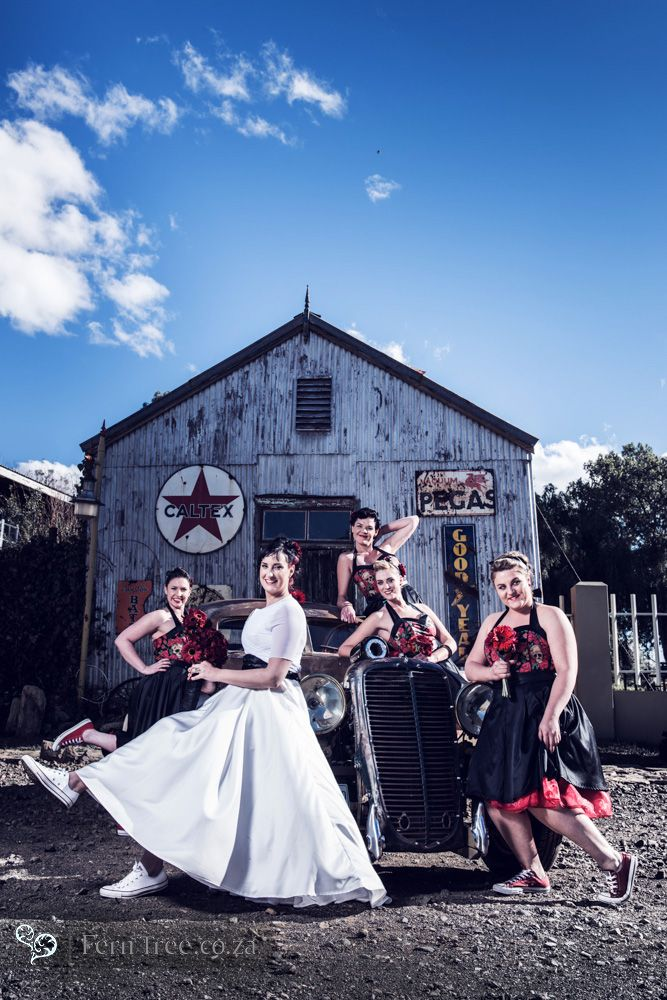 These bridesmaids had such fun at the rockabilly wedding. The skull detail on the dresses was very unique and super trendy. loved the converse shoes!