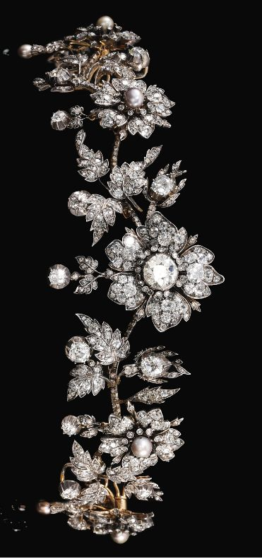 An antique natural pearl and diamond tiara, late 19th century. Designed as graduated foliate sprays suspending diamond and natural pearl drops, set with cushion-shaped, circular-, single- and rose diamonds and natural pearls, inner circumference approximately 278mm, five flower head detachable, accompanied by a fitted case. #antique #tiara