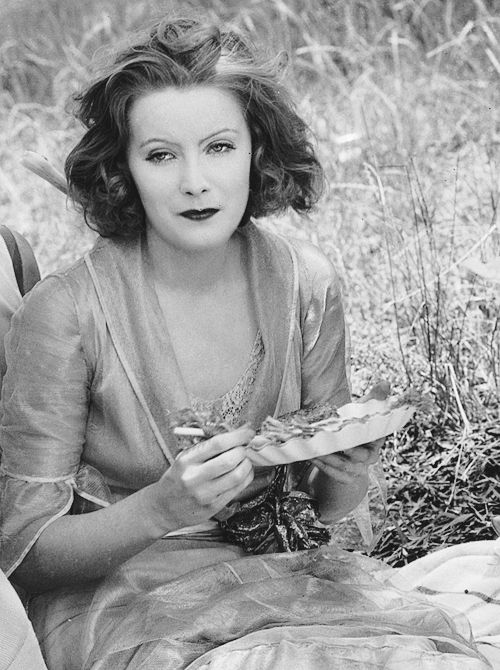 Greta Garbo picnicking in July during the filming of Love (1927)