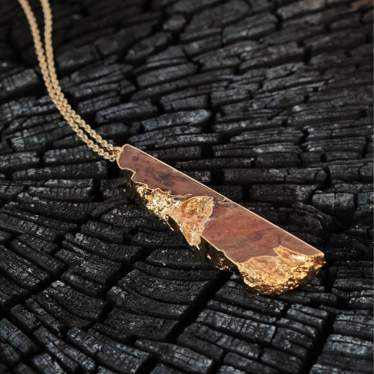 Loving the contrast of this Old English Oak and 22ct yellow gold pendant against a charred wood ember. #woodworking #woodjewelry #woodjewellery #woodcarving #woodandmetal #fifthanniversary #organicjewelry #organicjewellery #5thanniversary #bespokejewellery #bespokejewelry #alchemy