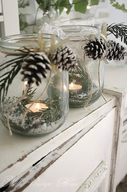 faux snow, lace, pine, and pinecone candle holders make pretty winter tabletop centerpieces