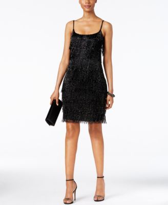 Adrianna Papell Beaded Fringe Dress $299.00 Shimmer and shake the night away in this eye-catching fringe dress, featuring a thoroughly modern flat-beaded center panel. By Adrianna Papell.