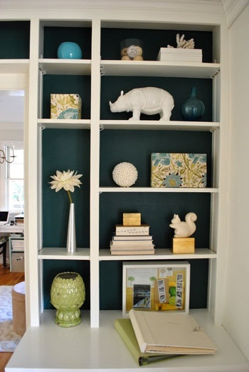 paint back of shelves dark to make light things pop and increase clean feeling... would work well in bathroom for towels, etc.