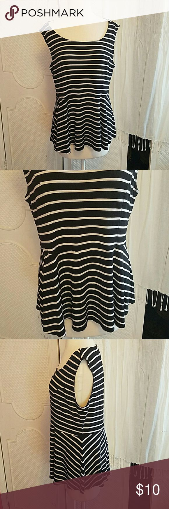 Black & White Striped Peplum Torrid Top Great condition. Has a bit of pilling in arm pits but hardly noticeable. torrid Tops