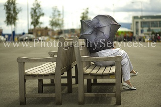 Unrecognisable woman with an umbrella on the wind