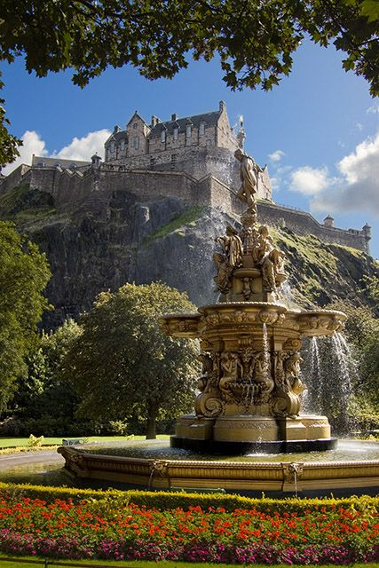 Edinburgh Castle and Ross Fountain in the Princess Street Gardens, Scotland.