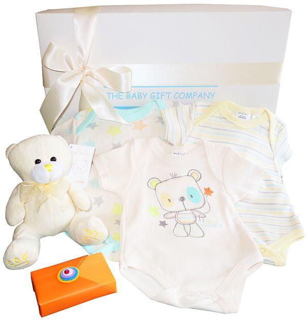 A special baby gift hamper for a newborn baby boy or baby girl. A cute teddy bear , classic cotton babywear. Baby gift ideas for hospital
