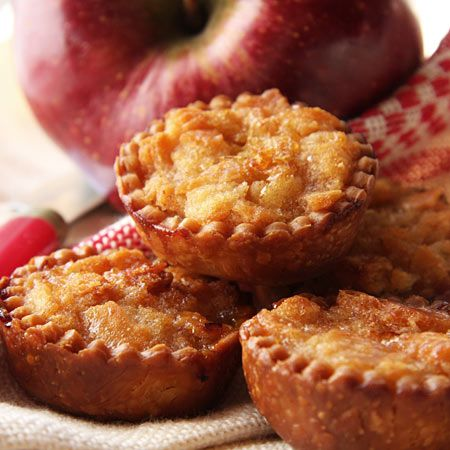 Printed on the back of Ritz Cracker boxes starting in 1935, the recipe for mock apple pie was a sensation. We've modified it here, to make bite-sized minis that are a nice, nut-free, cookie-like alternative to pecan-tassies.