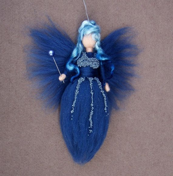 MIDNIGHT FAIRY The doll is handmade by my needle felt soft sculpture technique. Her measure is approximately 8 height. She comes in a blue colour with