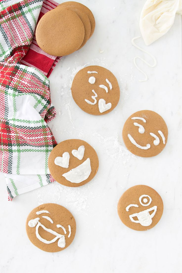 Bake + decorate a dozen Gingerbread Emoji Cookies with this holiday recipe.