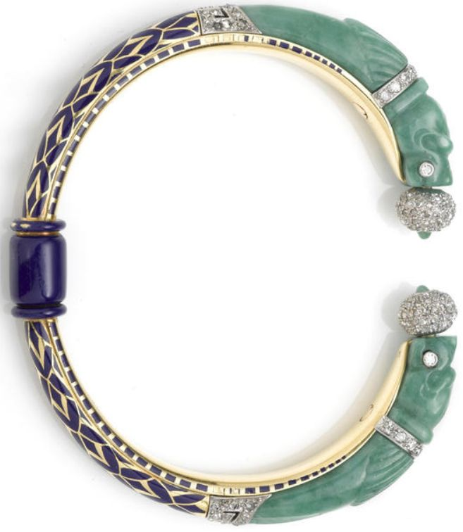 An art deco jadeite jade, enamel and diamond bangle bracelet, French, circa 1925     rotating cuff bangle with carved jade dragon terminals; with French assay marks; mounted in eighteen karat gold and platinum; diameter: 2 1/2in. Via Bonhams.