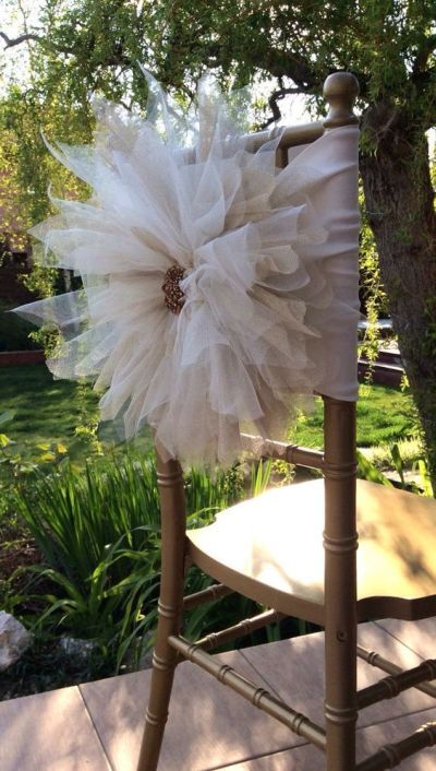 Decorated chair cover for a bridal shower.  See more bridal shower decorations and party ideas at www.one-stop-party-ideas.com