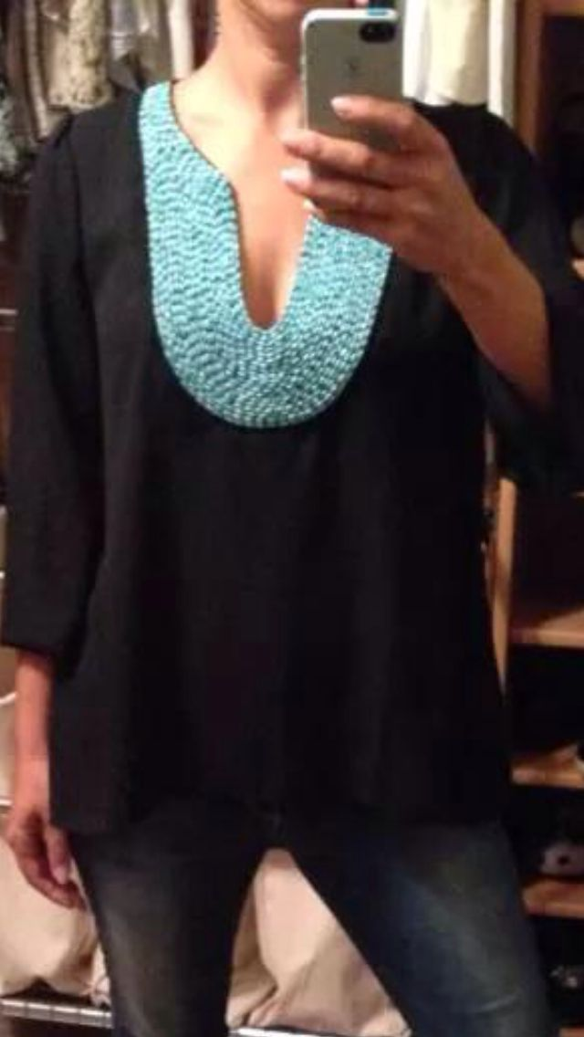I'd love this if it were sleeveless. Cute detail around the neckline. I like the black and turquoise as well.