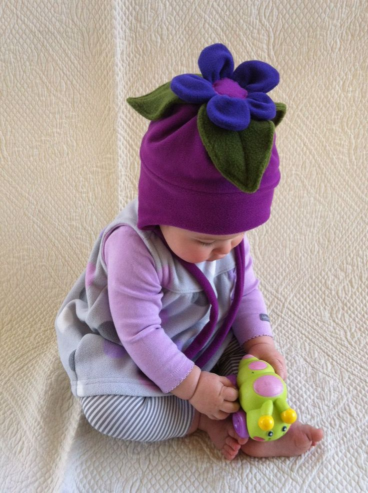 Fushia colored Fleece tie hat with Posie Silly by Stringbeanies, $30.00