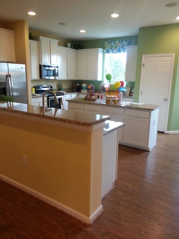 Redbud model home kitchen decorating staging model for Model home kitchens