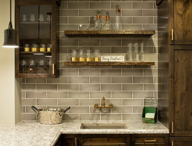 The cabinets were made of knotty alder wood. They were stained with a custom mix by the cabinet maker. Door Style – Kendall Panel, Full Overlay. Wood Species – Knotty Alder. Finish – Praline/Charcoal Glaze.