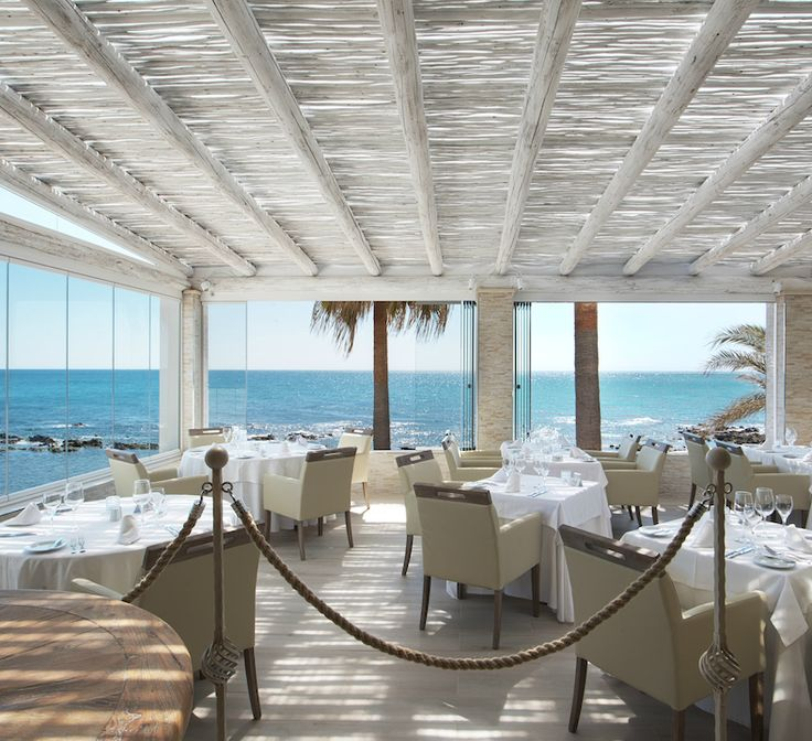 Whitewash pergola terrace at El Oceano Restaurant, Marbella, Spain. Would be really beautiful for an outdoor space at home!