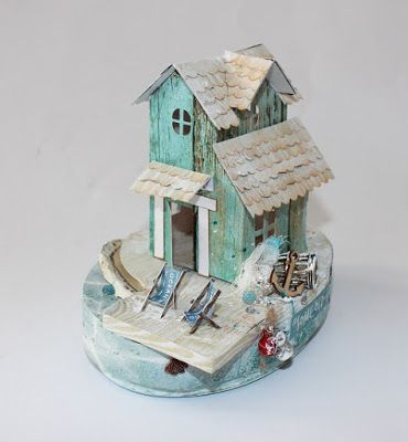 A beach miniature tea light house / putz house created with the Coastal Escape collection for Kaisercraft. Created by Kirsten Hyde.