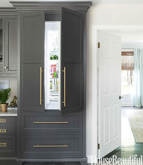 gray and white kitchen with built in refrigerator cabinet