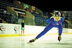 Female postgraduate speed skater and sports bursar training at the National Ice Centre, Nottingham