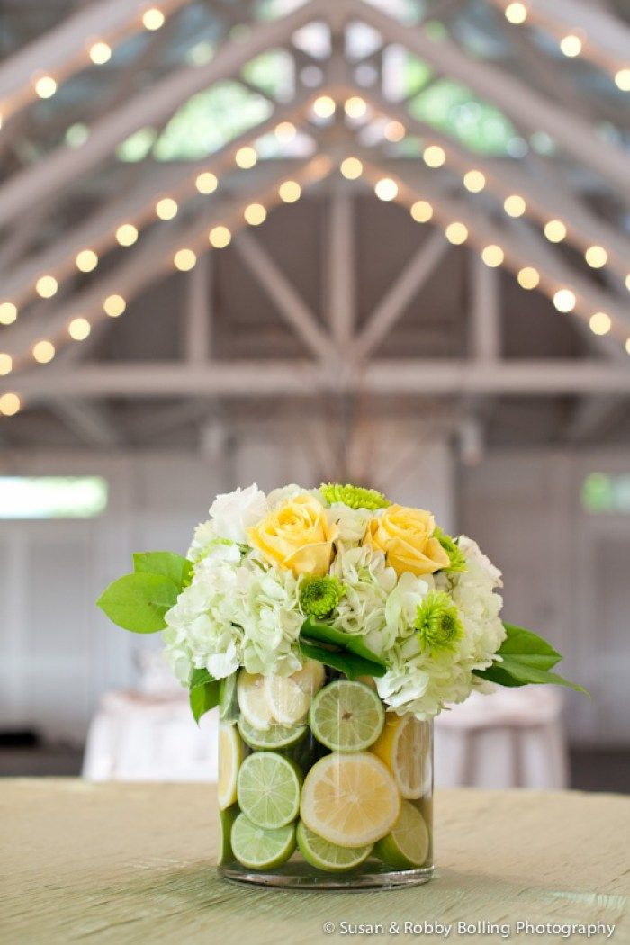 This floral centerpiece with lemons and limes is a great way to incorporate something fresh.