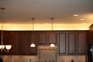 Trying to come up with ideas for how to decorate above the cabinets. Lighting only