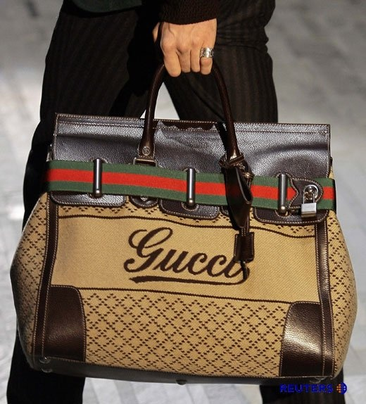 Not usually one for ostentatious logos but I'd make the exception for this bag- Gucci man-bag