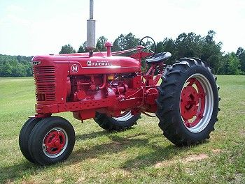 "Farmall ""M""  ""This ole tractor has been in the family awhile, my Dad sold it to my cousin then,  then around fifteen years later bought it back,  I restored it completely from the bottom up a couple of years ago, what you see here is the finished product ""   What I saw was impressive indeed.  I only wish we had a few before and after photo's.  That way you really could appreciate the overall amount of work that goes into restoring these old tractors."