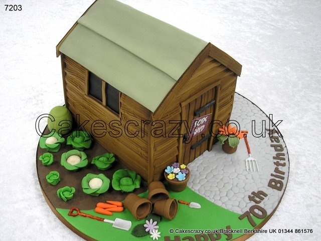 Garden Shed Cake.Garden shed novelty cake decorated with a selection of vegtables, flowers, and pots, and all the usual paraphernalia found around the garden shed to trip up on. In ideal cake for lovers of gardening or one who potters around their shed