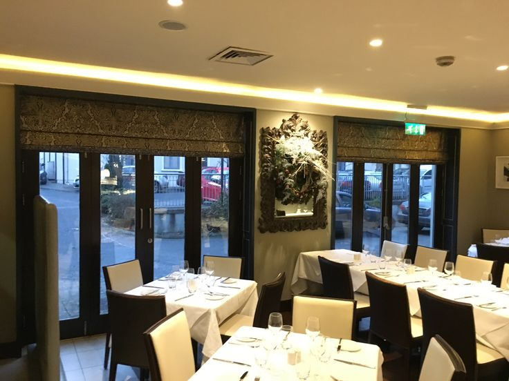 Very large roman blinds installed in a clients restaurant add a little bit of drama to the large door windows.