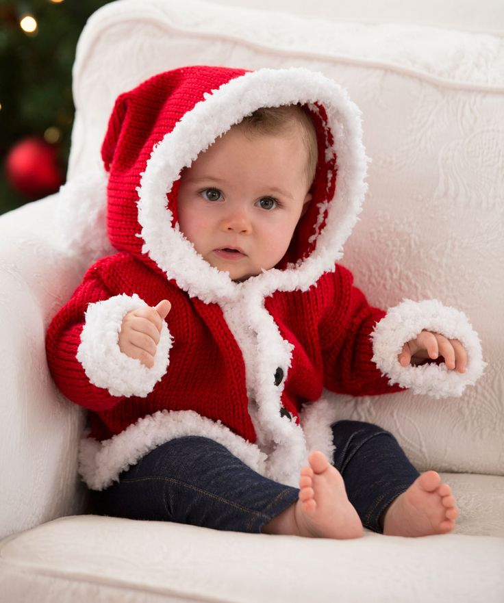 Knit a hooded sweater to keep baby warm while enjoying the holiday season. We've shown it in traditional Santa red, but you may choose any color for your special little elf!