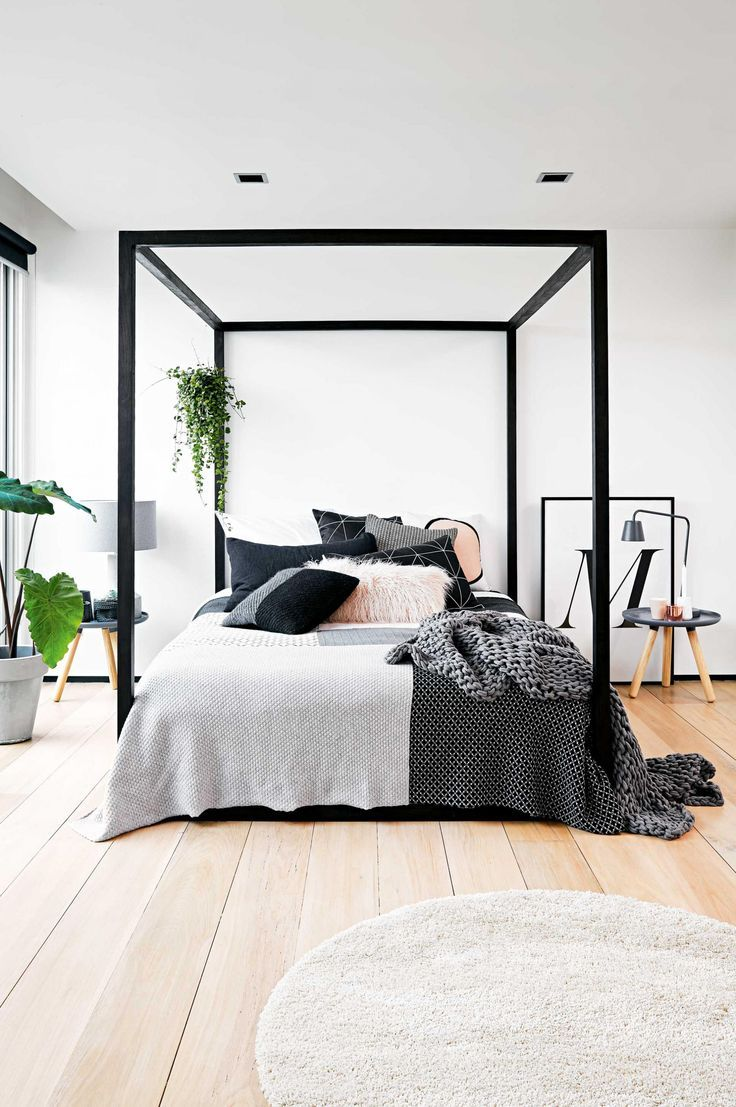 Modern canopy bed ideas - A Bright And Inviting Three Storey Warehouse Apartment Black Canopy Bedsmodern