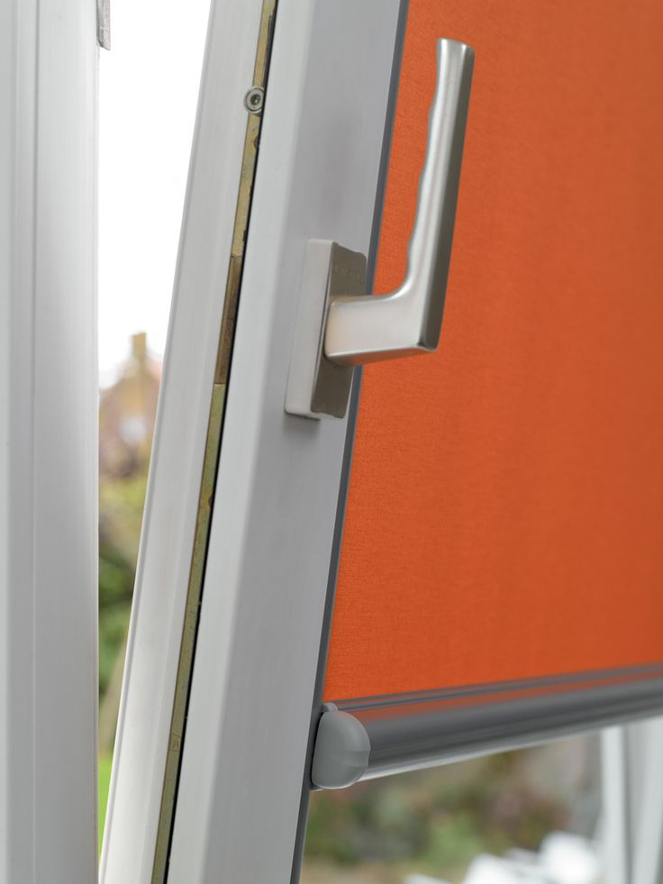 Luxaflex Nano Roller in vivid orange.  Ideal for tilt and turn windows.  Compact, practical yet stylish.  #Luxaflex #Roller #blinds #orange