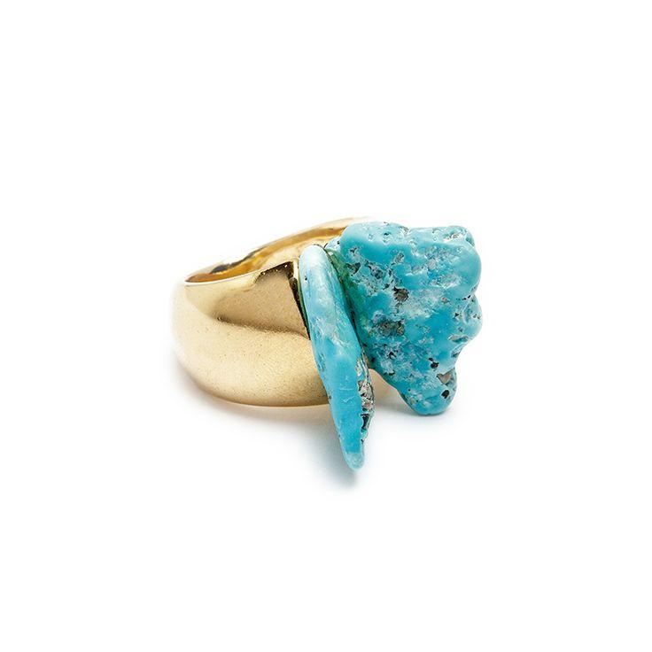 Anel com base de metal dourado e pedra turquesa