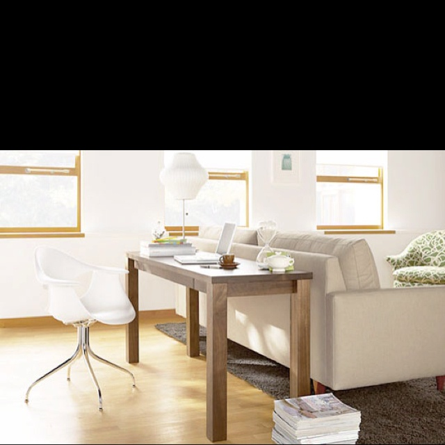 Use sofa table behind couch for a desk in our apartment