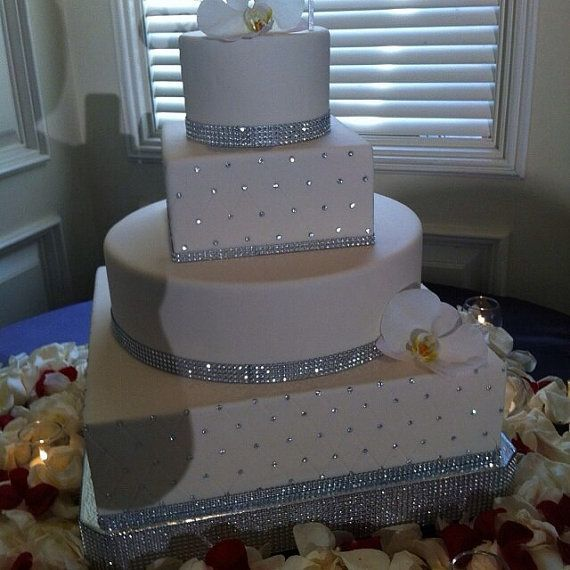 White lattice wedding cakes with edible diamonds