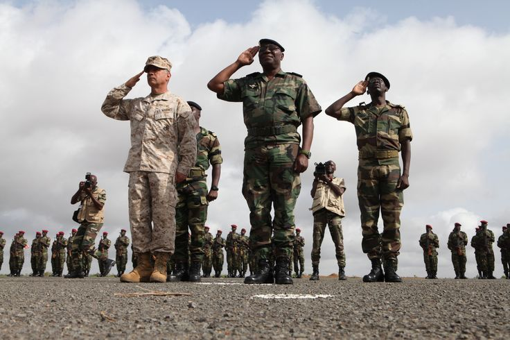 U.S. Marine Corps Col. Anthony Fernandez III and Chief of Staff of the Senegalese Army Brig. Gen. Papa Samba Kamarasalute the Senegalese flag during the national anthem as part of the closing ceremony for exercise Western Accord 2012 [5616 x 3744]