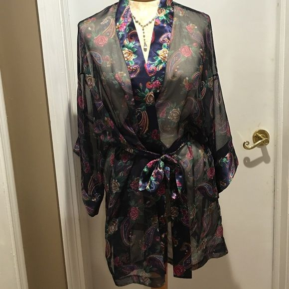 Victoria's Secret sheer paisley robe Victoria's Secret sheer paisley robe like new. May have used once. Not a big robe person. Sheer at least. With 4 kids I have mommy robes! Haha Dark navy blue Victoria's Secret Intimates & Sleepwear Robes