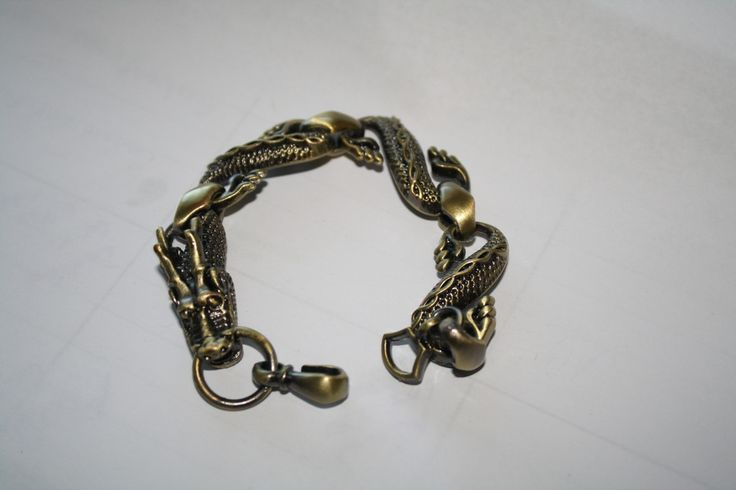 Weaved Dragon Bracelet #bronze #dragon #jewelry #pretty #silver #statement #steampunk  40% off orders over $50.  Free shipping and handling orders of $25 or more.  #Christmas #Present  www.ceesquared.ca