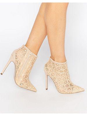 nude beige heels kicked off