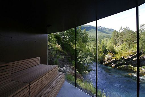The sauna at the Juvet Landskapshotell in Gudbrandsjuvet, Norway. The hotel consists of a farmhouse, a barn, plus seven detached hotel rooms scattered in the foliage, each with at least one wall made entirely of glass, and none overlooking another.