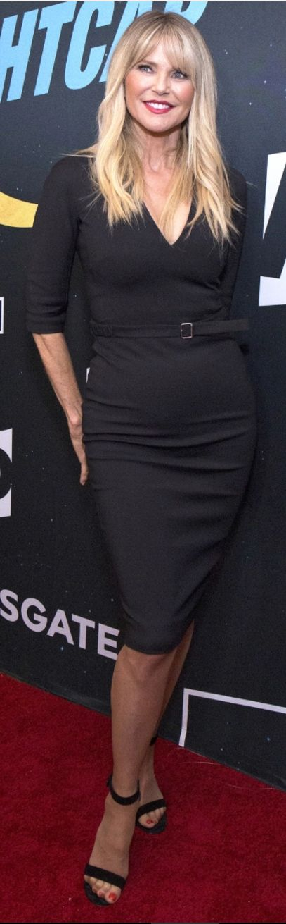 Who made Christie Brinkley's black belted dress?