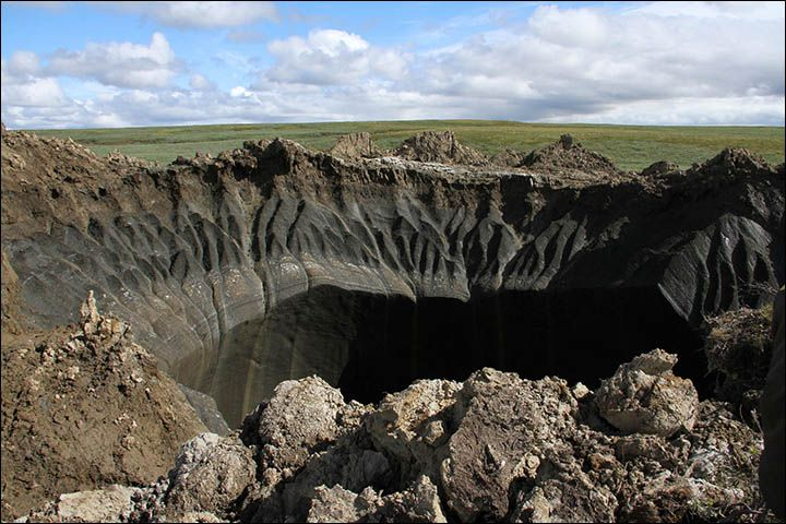 First pictures from inside the 'crater at the end of the world' - upper crater wall.   The first scientists have just returned from the crater on the Yamal Peninsula of Russia and are now using satellite photos to fix when it formed.  The crater is from 50 to 70 meters deep and about 30 meters in diameter - though somewhat oval.
