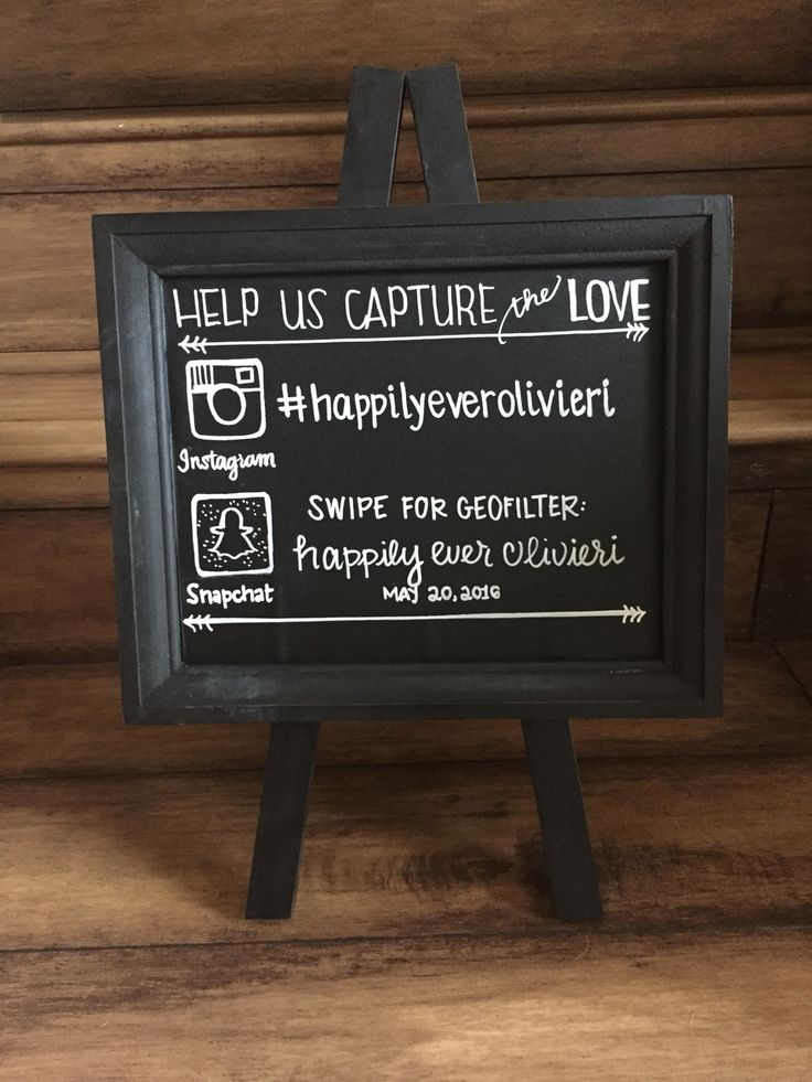 Wedding chalkboard for social media placed by the photo booth. Hashtag for Instagram and custom geofilter for snapchat