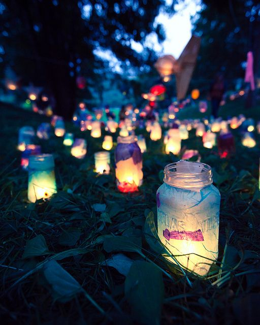 Forget paper bag luminaries...mason jars are the way to go.  Save those spaghetti sauce jars or find cast-offs at the thrift store then use a little white glue to apply recycled tissue paper to the outsides of the jars...drop in some beeswax tea lights and you've just made magic...