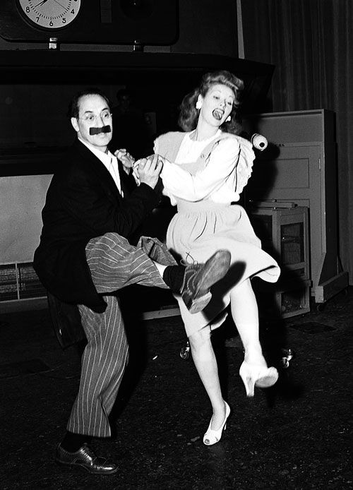 Lucille Ball and Groucho Marx clown about at CBS's KNX radio studios,c. 1945.: