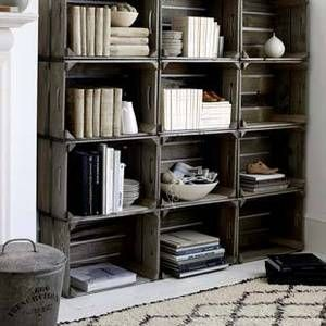Crates make a beautiful home library, and like books they can hold so much history / Library of Crates.  Two old crates came with the house, but one ended up not being usable.  I'd love to stumble across some more; I love this rustic look.