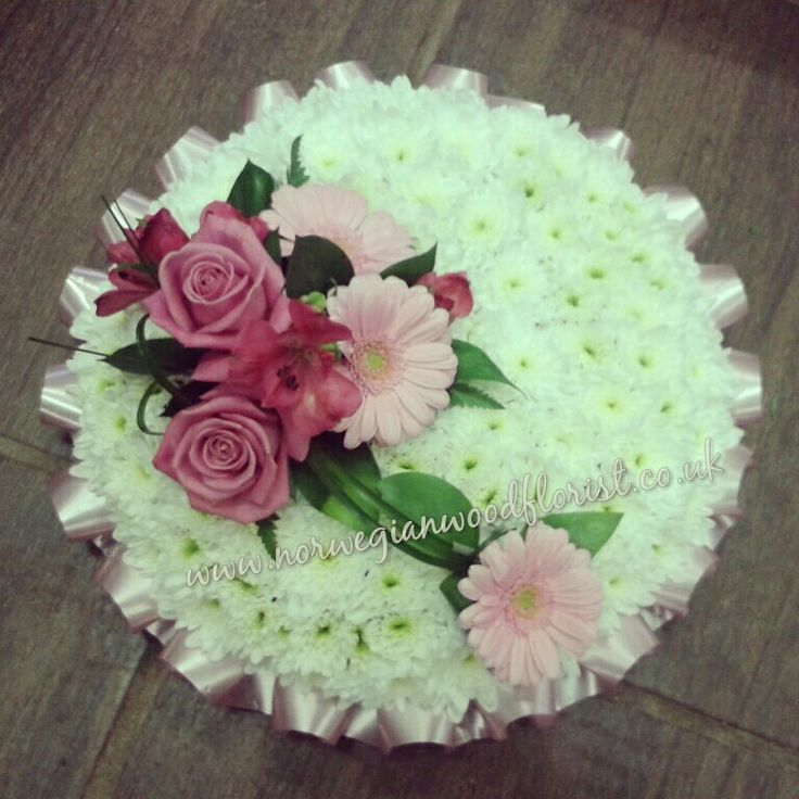 Pink and white posy pad  Funeral flowers by Norwegian Wood Florist