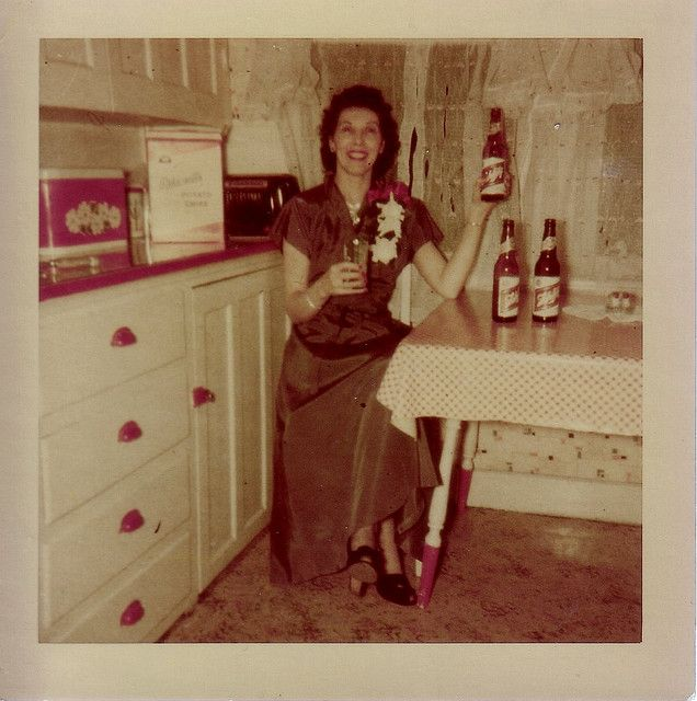 Inez did not see a problem drinking alone. In the kitchen. Wearing a corsage.